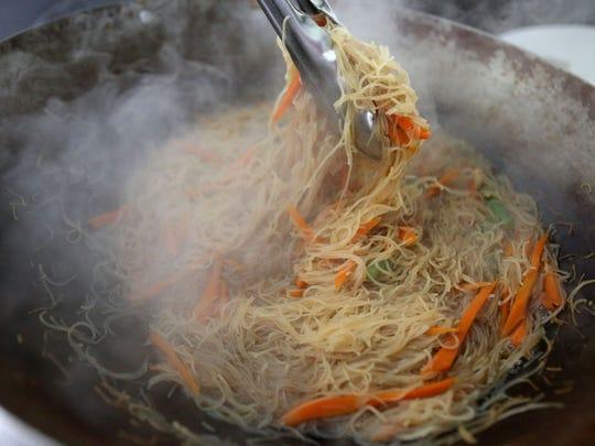 Stephanie Sosa prepares rice stick noodles.