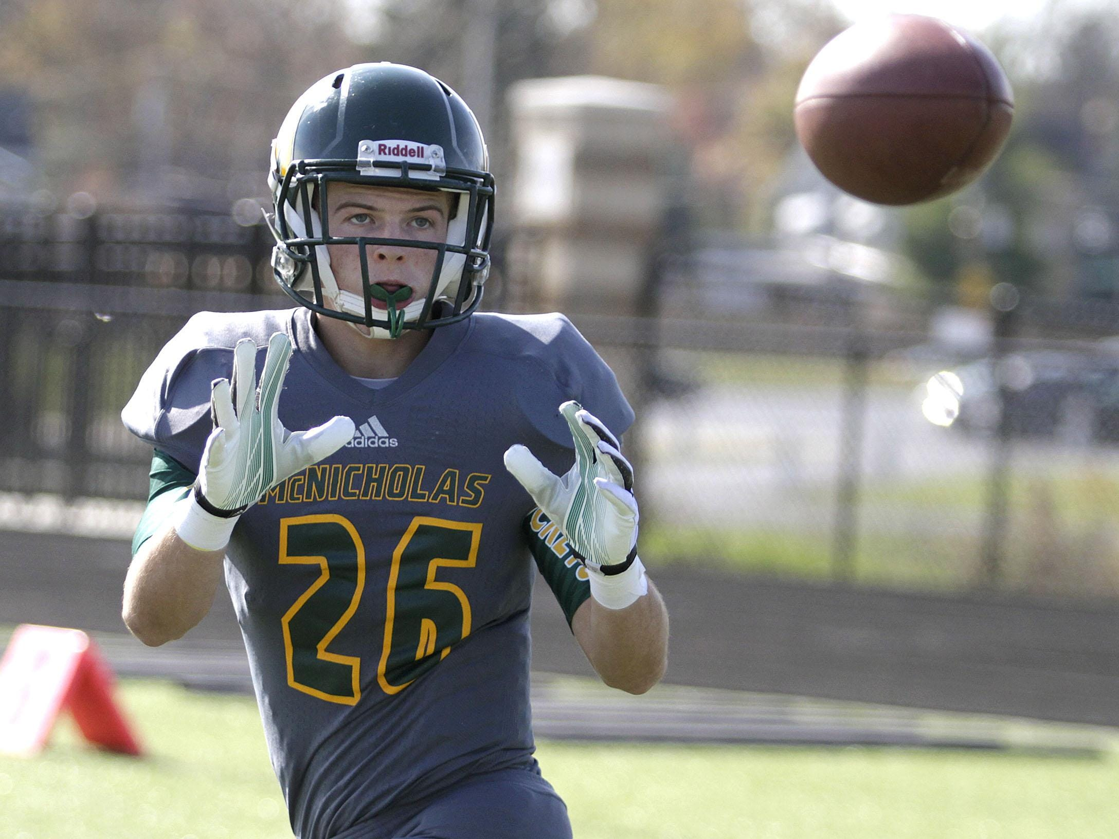 McNicholas' Adam Hisch of catches a pass during their playoff game against Norwood.
