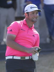 Jon Rahm reacts to his drive on the 10th hole of the