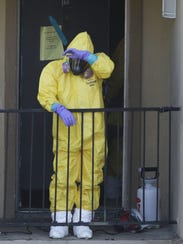 A hazardous-material cleanup worker wearing DuPont