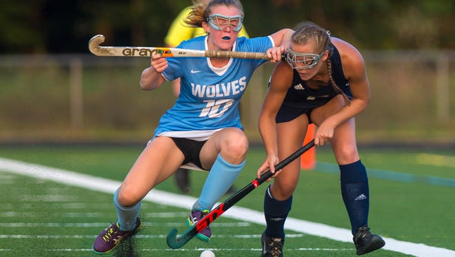 South Burlington's Odessa O'Brien, left, gets tangled up with Mt. Mansfield's Abby Carter in South Burlington on Wednesday, September 27, 2017.