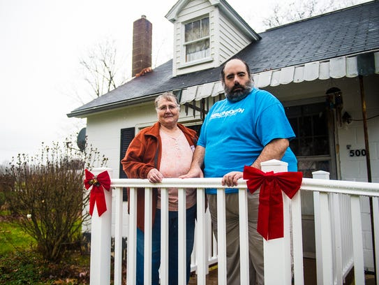 Carole Eppley and her son, Michael Eppley, stand on