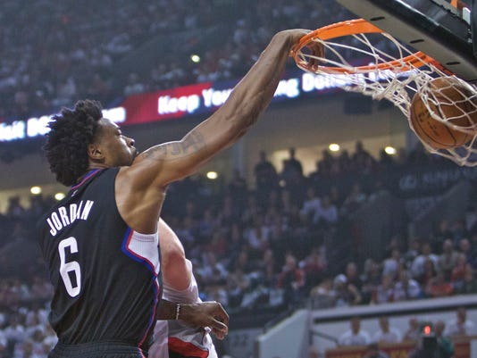 Los Angeles Clippers center DeAndre Jordan dunks against the Portland Trail Blazers during the first half of Game 6 of an NBA basketball first-round playoff series Friday, April 29, 2016, in Portland, Ore. (AP Photo/Craig Mitchelldyer)