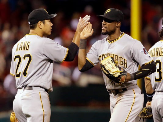 Pittsburgh Pirates' Jung Ho Kang, left, and Starling Marte celebrate following a baseball game against the St. Louis Cardinals Friday, May 6, 2016, in St. Louis. (AP Photo/Jeff Roberson)