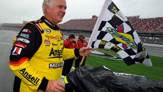 Driver Frank Kimmel celebrates on pit road after winning the rain-shortened ARCA Racing Series event at Talladega in May of 2013.
