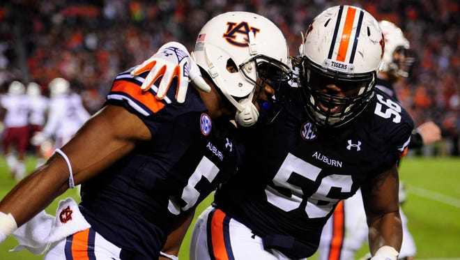 Auburn wide receiver Ricardo Louis (5) celebrates a touchdown with offensive lineman Avery Young (56) during the second half on Oct. 25 at Jordan Hare Stadium.