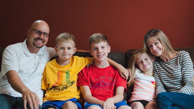 Former St. Cloud Cathedral standout athlete Jamie Dukowitz, left, is pictured with his sons Henry, age 10, and Owen, age 11, as well as daughter Violet, age 7, and wife Julie.
