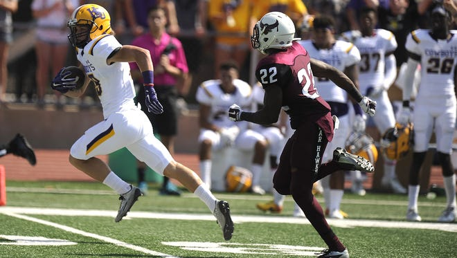 Hardin-Simmons wide receiver Reese Childress (19) sprints past McMurry defensive back Ryan Williams (22) during the first quarter of the Cowboys' 31-13 win on Saturday, Oct. 10, 2015, at Wilford Moore Stadium.