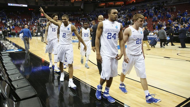 The Kentucky Wildcats walk off the court after defeating the Hampton Pirates Thursday in Louisville.