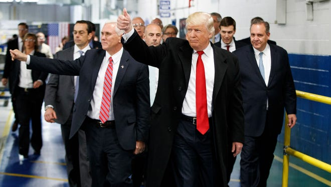 FILE - In this Thursday, Dec. 1, 2016 file photo, President-elect Donald Trump and Vice President-elect Mike Pence wave as they visit to Carrier factory, in Indianapolis, Ind.  (AP Photo/Evan Vucci, File)
