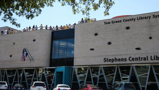 People gather on the roof of the Stephens Central Library to view the solar eclipse Monday, Aug. 21, 2017, in San Angelo.