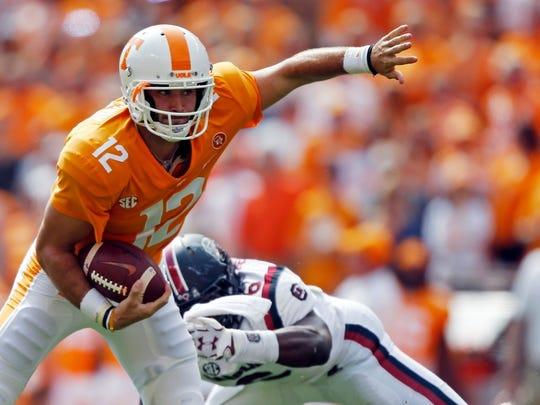 Tennessee quarterback Jarrett Guarantano (12) escapes
