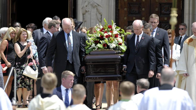 Pallbearers carry Gordie Howe's casket to the hearse following the service Wednesday afternoon at the Cathedral of the Most Blessed Sacrament in Detroit.