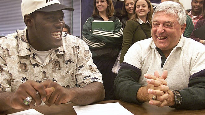 Former Fort Myers High coach Sam Sirianni, here with Savarris Brown, enjoyed helping youths throughout Lee County and not just those attending Fort Myers.