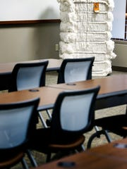 A 500-pound bale of cotton sits in The Seam's training room.