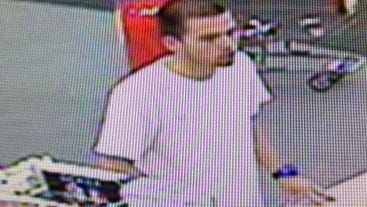 Surveillance image of a man suspected of robbing an east Naples pharmacy.
