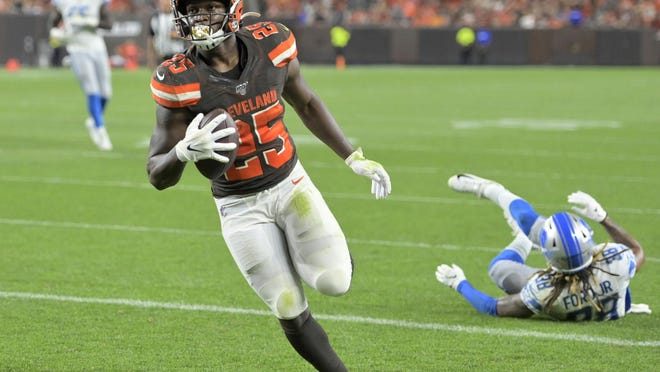 The Browns'  Dontrell Hilliard gains some yardage during a game.