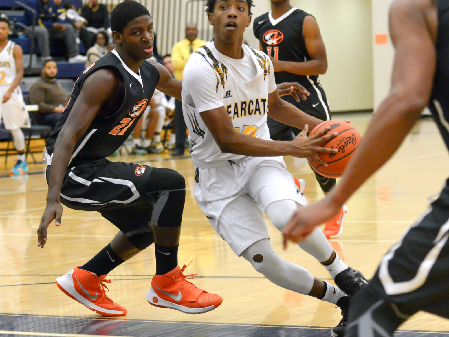 Central's Jahmiel Wade drives the basket Tuesday night.
