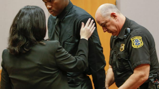 Former MSU football player Josh King is taken into custody by a court officer before leaving 54B District Court June 7, 2017.  He was arraigned in Judge Richard Ball courtroom on sexual assault charges.  Also pictured is his attorney Shannon Smith.   [MATTHEW DAE SMITH/Lansing State Journal]