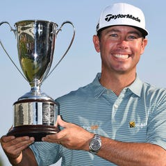 Chez Reavie hits off the ninth tee during the final round of the Travelers Championship golf tournament, Sunday, June 23, 2019, in Cromwell, Conn. (AP Photo/Jessica Hill)
