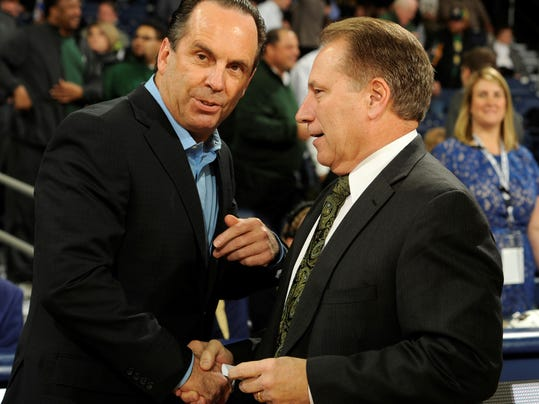 Michigan State coach Tom Izzo, right, talks with Notre Dame coach Mike Brey before an NCAA college basketball game Wednesday, Dec. 3, 2014, in South Bend, Ind.  (AP Photo/Joe Raymond)