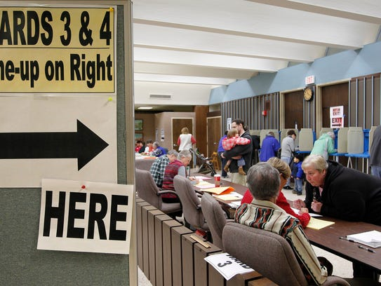 Voters sign up to vote in 2012 at Waukesha City Hall,