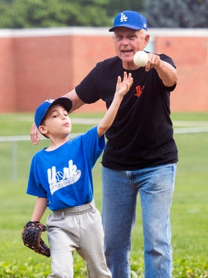 Tom Diehl, right, with his grandson Noah Diehl, 6, during T-ball at Stoney Brook Elementary School in Springettsbury Township York.