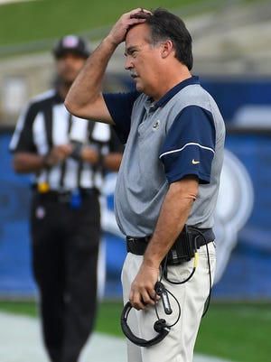 Los Angeles Rams head coach Jeff Fisher watches the first half of Sunday's NFL game against the Atlanta Falcons. Fisher tied Dan Reeves for the most career losses by a head coach.