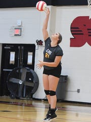 Camden's Brittney Minor serves the ball to South Side during their game Thursday, Sept. 7.