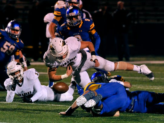 Comanche running back Colton Roberts loses the ball after it was knocked from his arm by Brock linebacker Dawson Littlepage during Friday's game. Brock won the 3A Division 1 quarterfinal at Shotwell Stadium, 34-7.