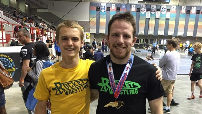 Reynolds wrestling coach Austin Reece, right and Sam Mosby.