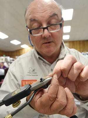 British angler Chris Reeves ties French Partridge Mayfly during the 19th Annual Sowbug Roundup at the Baxter County Fairgrounds on Thursday. The event continues Friday and Saturday with doors opening at 9:00 a.m.