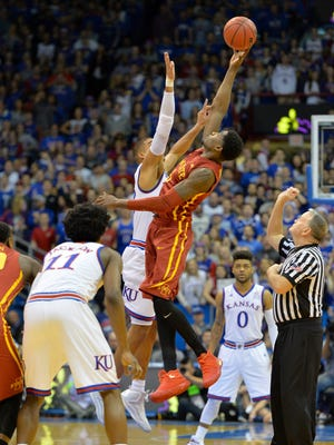 Kansas Jayhawks forward Landen Lucas (33) and Iowa State Cyclones forward Merrill Holden (5) fight for the opening jump ball during the first half at Allen Fieldhouse.