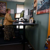 Susan Luparell, a professor at MSU College of Nursing in Great Falls, uses a treadmill work station. After learning how to work on a computer while walking, she noticed the neck and back pain she had been feeling had disappeared.