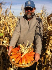 Torbert Rocheford with his corn at Purdue's Agronomy