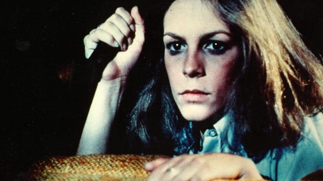 "Jamie Lee Curtis wields a knife in the 1978 horror film classic ""Halloween,"" directed by John Carpenter."