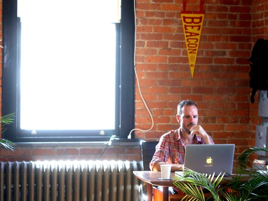Scott Tillitt, founder of The Beahive, a shared workspace in Beacon, works at his laptop at the Beahive's office on Main Street Sept. 27, 2017.