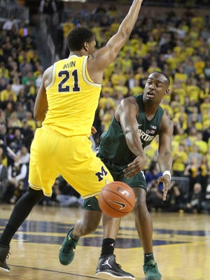 Michigan guard Zak Irvin defends against Michigan State guard Joshua Langford during the first half Tuesday, Feb. 7, 2017 at Crisler Center.