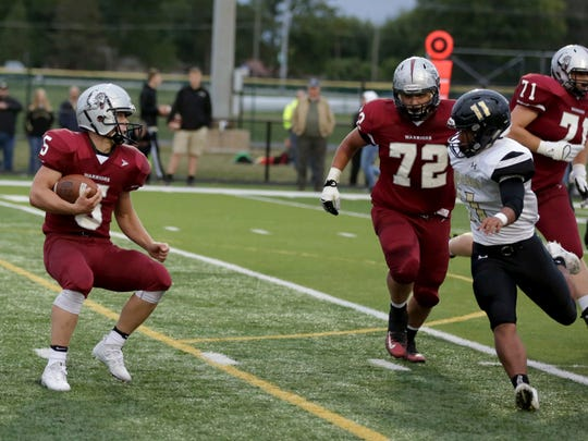 Kaleb Marr (72) helps clear the way for Danville's