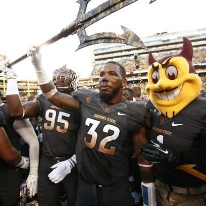 Arizona State's Antonio Longino celebrates a 55-31