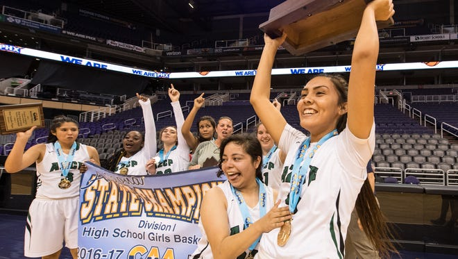 AZ Compass' Alliyah Silver (3) and Marrisa Ulate (23) lift up their championship trophy after winning the Division I Canyon Athletic Association title on Tuesday.