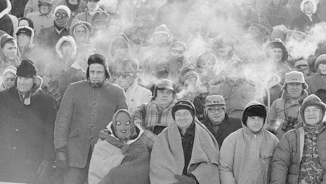 Fans watch the Green Bay Packers play the Dallas Cowboys in the NFL Championship game on Dec. 31, 1967, in Green Bay.