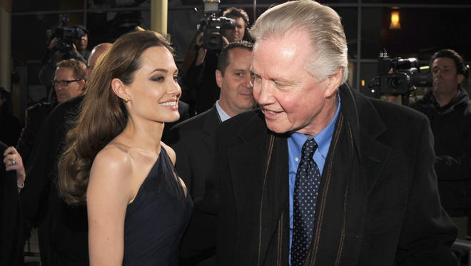"""Angelina Jolie and Voight arrive at the premiere of FilmDistrict's """"In the Land of Blood and Honey"""" held at ArcLight Cinemas on December 8, 2011 in Hollywood, California."""