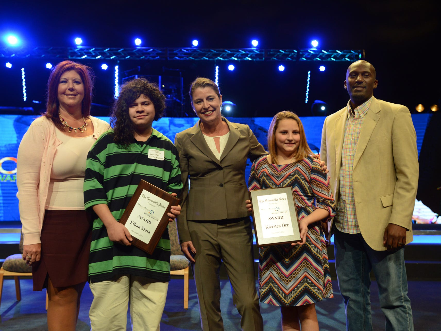 Ethan Mata and Kiersten Orr of Greenville Early College receive The Greenville News Coaches 4 Character Award on Monday as they stand with their principal Dr. Tiffany Estes, left, Coach Joanne P. McCallie of Duke University, center, and Manie Robinson of The Greenville News, right.