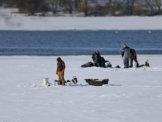 Anglers try their luck ice fishing along the Fox River