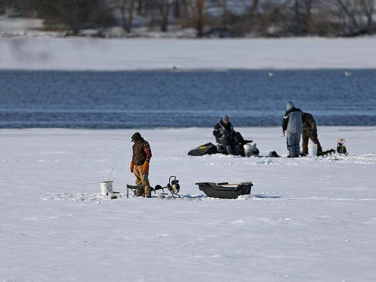 Anglers try their luck ice fishing along the Fox River near Voyageur Park in De Pere.