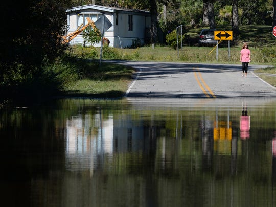 Belle Ward stands at the end of Fork Retch Court in Mullins on Thursday. The street where she and her husband Morris have their home flooded since Hurricane Matthew hit the coast. Thursday, October 13, 2016.