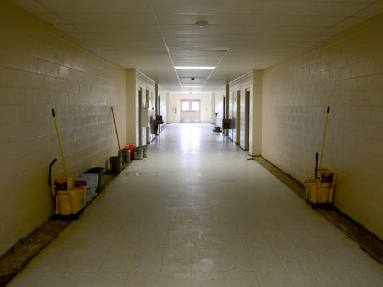 Inmates in the Tennessee Department of Correction are cleaning out the former West Middle School building to allow the Madison County Sheriff's Office to move into the closed school.