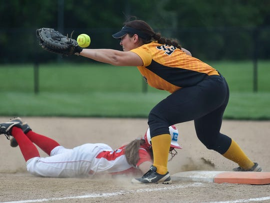 The ball flies only a few inches over the glove of Colonel Crawford's Lydia Strouse during Colonel Crawford's regional semi-final loss to Eastwood Wednesday at Findlay.