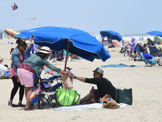 Umbrellas were set up as cool and windy weather held